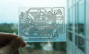 Inkjet-based Circuit - A single-sided wiring pattern for an Arduino micro controller was printed on a transparent sheet of coated PET film.
