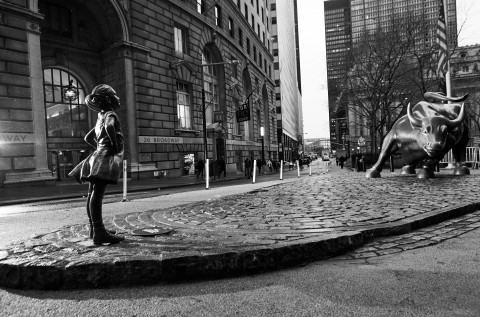 The Fearless Girl Statue near the Charging Bull of Wall Street